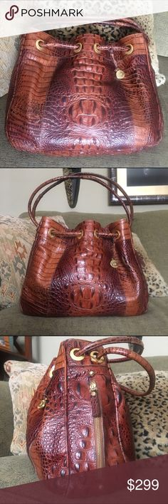 Brahmin Pecan Bag Gorgeous Brahmin drawstring clinch bag in beautiful Pecan color. EUC, minimum ware, clean inside and out! Great size! Retired style, hard to find. If you have any questions, please ask! 💞 Brahmin Bags Shoulder Bags