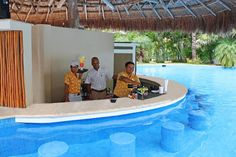 Swim up and grab a cocktail at our pool bar at Secrets Aura Cozumel!
