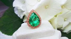 Stunning 7 carat Emerald in a rose gold halo by David Klass Jewelry.