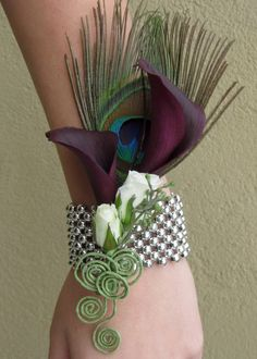 Calla lily wrist corsage with peacock feather- something like this for moms but with ribbon instead of the bracelet. @Emily Schoenfeld Schoenfeld Pair