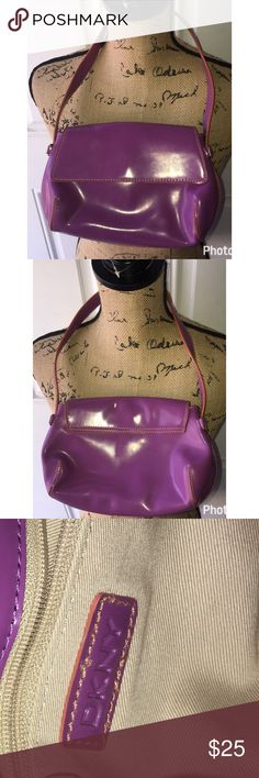 DKNY small purple purse DKNY purple shiny purse small dose have scuffs on it have not Tried to get them out but I'm sure it's possible DKNY Bags Mini Bags