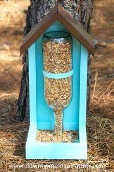 Wine bottle bird feeder tutorial.   Down Home Inspiration #woodcraftprojects #DIYHomeDecorWineBottles