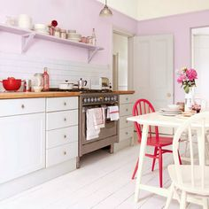 Kitchen with pastel pink walls. For more decorating ideas visit Redonline.co.uk