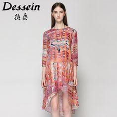 Printed silk dresses with cropped sleeves make loose