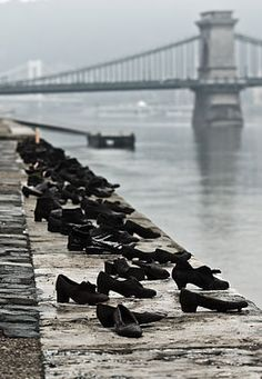 Shoes on the Danube Promenade - A row of 60 pairs of bronze shoes that look suddenly abandoned. The memorial was created by sculptor Gyula Pauer. It honors the Jews who were killed by the fascist Arrow Cross militiamen in Budapest during World War II. They were ordered to take off their shoes, and were shot at the edge of the water so that their bodies fell into the river and were carried away.