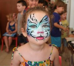 Fabulous asymetrical Mark-Reid-esque facepaint: girly tiger face painting
