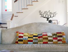 patchwork pillow - I hate squishy pillows, but I love the look of this - it's oversized-ness appeals to me Patchwork Pillow, Quilted Pillow, Long Pillow, Sewing Pillows, Velvet Pillows, Crafty Projects, Stores, Pin Cushions, Decoration