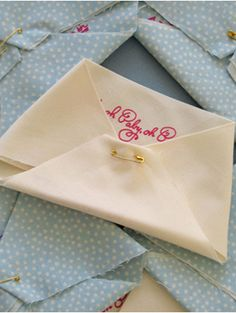 How cute! Think I'll have guests RSVP with a blank fabric triangle with a written message of baby advice to to create a pennant for the baby's room! (Or make this an activity at the shower.)