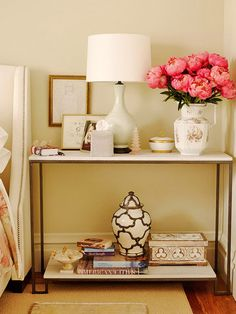 With no room for both a display table and nightstand, this small bedroom made use of a narrow console with two shelves, incorporating a few extra precious square inches for storage of beloved decorative items and daily-use essentials! http://www.bhg.com/decorating/small-spaces/strategies/storage-solutions-for-small-bedrooms/?socsrc=bhgpin041915multifunctionfurniture&page=9