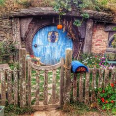 Autumn is coming to New Zealand and there are pumpkins all over Hobbiton, including dangling in front of hobbit holes. | Flickr - Photo Shar...