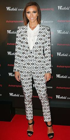 Last Night's Look: Love It or Leave It? | GIULIANA RANCIC | Do not attempt to adjust your monitor. It's just Giuliana creating an optical illusion in a very fitted geometric-print suit at a photocall in Melbourne, Australia.