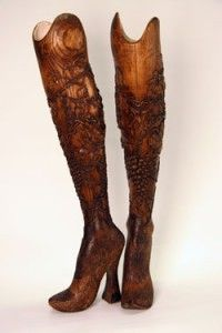 The hand-carved, high-heeled, wooden prosthetic legs used for a legless model in Alexander McQueen's 1999 fashion show. Supposedly inspired by the high-heeled, hand-carved legs worn by an 1800's Danish prostitute.