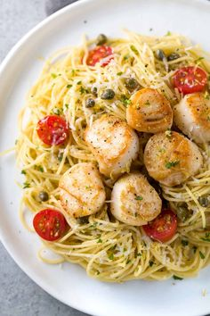 Pan Seared Scallops with Lemon Caper Pasta -An easy gourmet recipe for any occasion! Light angel hair pasta is tossed in a citrus white wine sauce and tomatoes.   jessicagavin.com