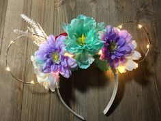 Ariel Floral Ears by NeverlandTradingCo on Etsy https://www.etsy.com/listing/516035577/ariel-floral-ears