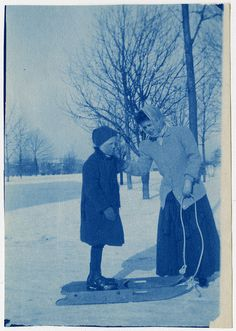 Louis Yott, a student who is deafblind, stands on a sled with the assistance of teacher Mrs. Sagar. At the Kindergarten for the Blind in Jamaica Plain, MA. Visit the Perkins Archives Flicker page: http://www.flickr.com/photos/perkinsarchive/collections/