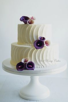 Round Wedding Cakes - Textured buttercream with plum calla lilies