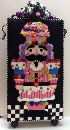 needlepoint nutcracker stand-up, with cupcake hat