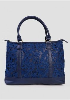 <p>Perfect for carrying all your essentials, this navy faux leather bag is accented with allover intricate lace and matte gold-toned hardware for added interest. Complete with a top zipper closure, this spacious handbag is the perfect finishing touch to any ladylike ensemble. By Darling UK.</p><p>Shell: 100% Polyurethane<br /> Trim: Lace<br /> Lining: 100% Polyester<br /> Imported<br /> 6.5