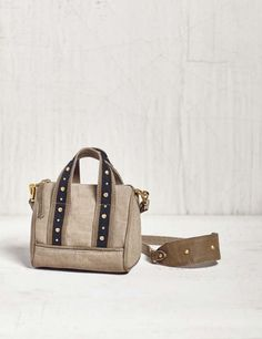 c321f55aded1 The Mona B Lucca small canvas crossbody bag has massive style in a small  package.