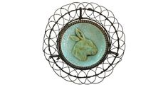 Majolica butter pat with rabbit made into a wire basket