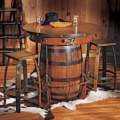 Love this for our basement. Western Pub Table and Stools - Adorned with all the trappings of the cowboy lifestyle, this innovative table is sure to be the focal point of any western style game room or den. Western Style, Saloon Western, Cowboy Western, Cowboy Theme, Western Bar, Western Kitchen, Western Belts, Barrel Furniture, Western Furniture