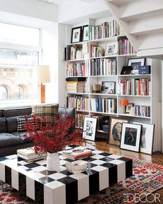 The living area's bookshelves hold a collection of photographs and offbeat treasures.
