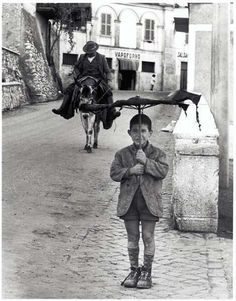 "Italy.  The ""Umbrella Boy"", Rome 1958 // photo by Bill Perlmutter"