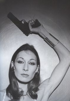 Looking tough with Angelica Huston - GM