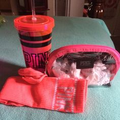 Pink make up bag and tumbler Selling as a bundle and throwing in these socks which have been used  once or twice .  These items come from smoke fee home. PINK Victoria's Secret Bags Cosmetic Bags & Cases