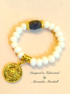 Love this fudge and vanilla colored bone and Tibetan Dzi bead stretch bracelet by Alexandra Marshall with brass accents. $32. Available in small medium & large sizes. #B2386. Double click photo to visit my web store.