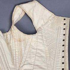 LOT 63 TWO WHITE COTTON CORSETS, 1825 - 1835 - whitakerauction