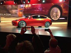 Tesla Motors unveils the new lower-priced Model 3 sedan in Hawthorne, Calif., on Thursday.