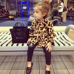 curly hair, topknot, leopard coat and leggings... it's my future nugget haha.