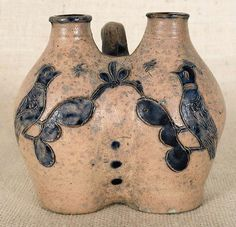 """Catalogue for October 27th 2012 Lot 160.  Paul Flack Collection.  Estimated: $15K - $25K.  Realized Price: $42,660.  New York or Connecticut stoneware gemel jug, ca. 1800, with incised cobalt love birds, 5 1/4"""" h. A related example was sold at Crocker Farm on October 31, 2009."""