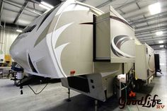 "2016 New Grand Design Reflection 303RLS Fifth Wheel in Iowa IA.Recreational Vehicle, rv, 2016 Grand Design Reflection , This all new Reflection is loaded with features including, power awning with LED lighting, theater seating, 32 LED TV, solid surface counter tops, pantry and more. For sale at Good Life RV., Furniture: Ball Bearing Full Extention Drawer Glides, Deep, 50/50 Kitchen Sink with 3.5"" drains, Ductless flooring Throughout Living Area, Full Size Pantry W/Adjustable Shelving…"