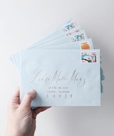 pretty dusty blue envelopes with gorgeous hand-lettering