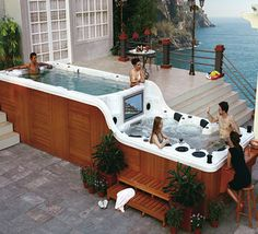 Double decker hot tub with bar and tv.