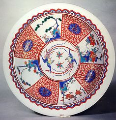 Plate Period: Edo period (1615–1868) Date: early 18th century Culture: Japan Medium: Porcelain painted in overglaze polychrome enamels and gilt (Arita ware, Kakiemon type) Dimensions: H. 2 3/4 in. (7.0 cm); W. 13 7/8 in. (35.2 cm) Classification: Ceramic