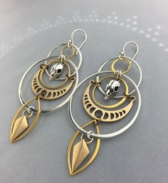 Intersecting circles of silver and 24k gold create and orbit pattern for these cosmic earrings. Life, death and our place in the universe are themes I