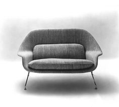Promotional photograph of the Model 70 Womb Settee, 1948 by Eero Saarinen | Knoll Inspiration