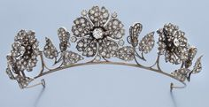 "French 19th C. diamond tiara / necklace / corsage / hairpin conversion in a floral design with three sections of flowers and four sections of leaves, mounted with old European and rose cut diamonds. In fitted leather, velvet and satin case for ""Charles Fontana & Cie., Palais Royal, 96 a 98, Paris"". 165.6 grams. Necklace 15""L, Circa - 1880."
