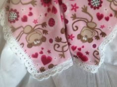 Pink fleece blanket with monkeys and a pretty crocheted edging