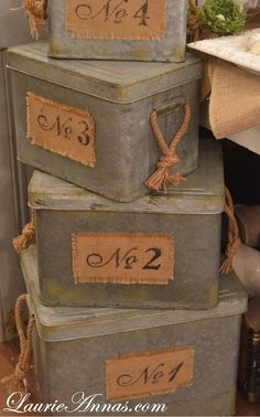 Idea for my antique looking cardboard hat boxes. Braid twine & attach on sides for similar handles. Paint numbers on scrap burlap, fray edges & hem inside.