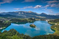 Lake Bled is a lake in the Julian Alps of the Upper Carniolan region of northwestern Slovenia, and one of the beautiful places to visit in Slovenia! Train Tour, By Train, Beautiful Places To Visit, Cool Places To Visit, Camper, Bled Slovenia, Bohinj, Adventure Magazine, Hiking Europe