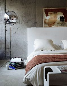 Concrete wall and basic furnitures This picture is from Los Peñascales in Spain, by architects ÁBATON. The project was awarded the 2008 Asprima-Sima Prize for best private housing development in Spain.