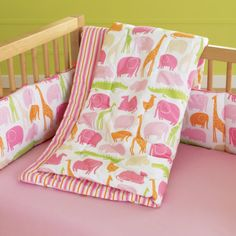 Love the colors in this girls baby crib bedding set from The Land of Nod. These shades of pink, orange and green go so well together.