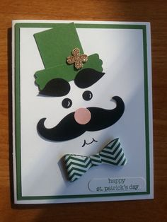 """This is my St Patty Day card inspired from a pin from a couple years ago posted by """"StampLadyKatie"""". I used the new Stampin' Up!  bow builder punch and the mustache framelit along with other Stampin' Up! punches. Cheers!"""