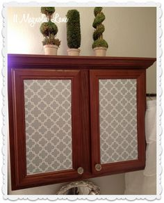 Upper cabinets with wrapping paper on the doors, using Krylon Easy-Tack.  She says the Easy-Tack turns wrapping paper to something more like vinyl or shelf paper and it's removable whenever you choose.  How cool! Even renters can use this decor method!