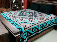 "Our Luxury Southwest Bedspreads feature new El Paso Saddleblanket designs in vibrant, classic Southwest colors.   Made from high quality acrylic, they incorporate a fine weave and a double-ply heavyweight material.   Imported. Done in a Turquoise Diamond design.  QUEEN SIZE: 88"" x 96"" KING SIZE: 114"" X 96"""