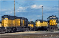 Chicago & North Western power is seen here around the turntable at Council Bluffs, Iowa on July 3, 1991.